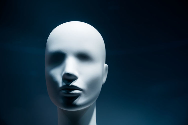 Close-up of mannequin against black background