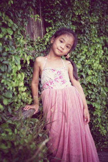 A cute little asian girl in a green park