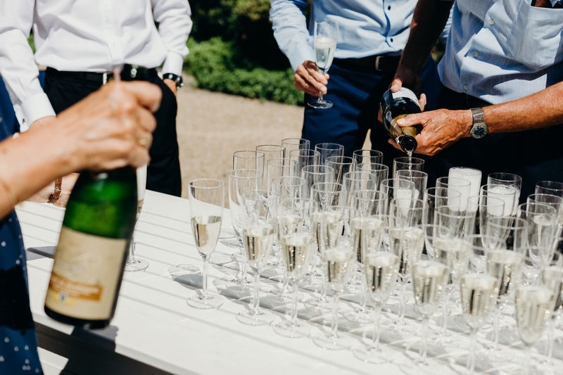 Toast for the newlyweds. Photos taken during a wedding in Copenhagen, Denmark. Wedding Wedding Photography Wedding Ceremony Wedding Day Wedding Toast Drink Champagne Celebration Celebrating Love Drinking Wedding Photographer Real Wedding Real People Food And Drink Glass Refreshment Alcohol Table Men Group Of People Midsection People Human Hand Container Hand Event Standing Day Holding