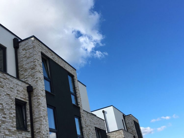Architecture Built Structure Building Exterior Low Angle View Window Blue Sky High Section Outdoors Cloud - Sky Façade Architectural Feature No People