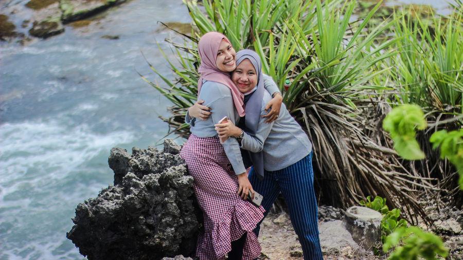 Portrait of smiling female friends wearing hijab