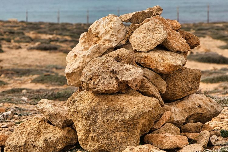 Close-up of stack of rocks on land