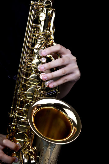 Music Instrument Alto Saxophone Player, Saxophone Player Isolated on black Music Human Hand Hand Musical Instrument Arts Culture And Entertainment Gold Colored One Person Saxophone Artist Performance Human Body Part Brass Instrument  Musician Playing Real People Skill  Musical Equipment Unrecognizable Person Brass Finger Black Background