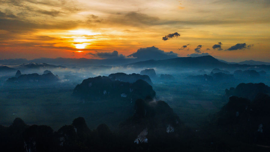 Sky Cloud - Sky Sunset Beauty In Nature Scenics - Nature Tranquil Scene Tranquility Orange Color Mountain Environment Idyllic Nature Fog Non-urban Scene Landscape No People Silhouette Mountain Range Outdoors Hazy