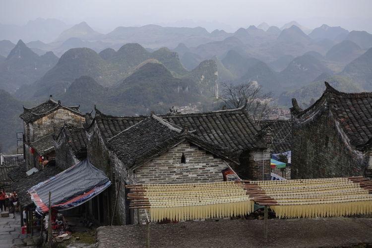A village on top of the hills Hills Village Life village Landscape