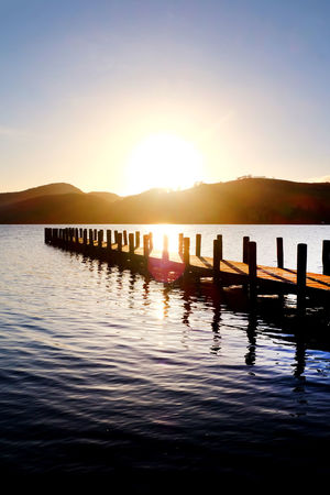 Coniston Waters Beauty In Nature Clear Sky Coniston Water Day Jetty Jetty Structure Jetty View Jetty, Pier Lake Lake View Mountain Nature No People Outdoors Reflection Scenics Silhouette Sky Sunlight Sunset Tranquil Scene Tranquility Water