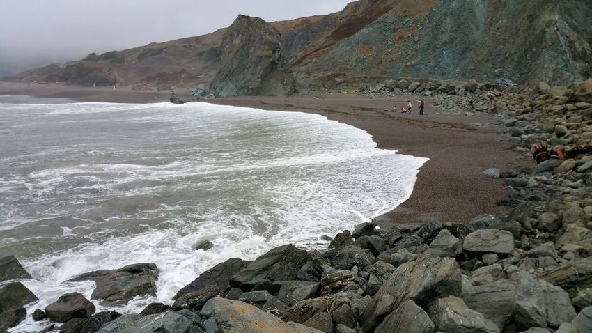 Family beach day. Time together at the ocean Family Together Playing Beach Sand Pink Blue Atmospheric Moody Foggy Fog Solitude Mysterious Misty Dramatic Waves White Foam Frothy Pattern Nature's Art Beach Sea Water Rock - Object Sand Sky Rock Formation Eroded Rugged