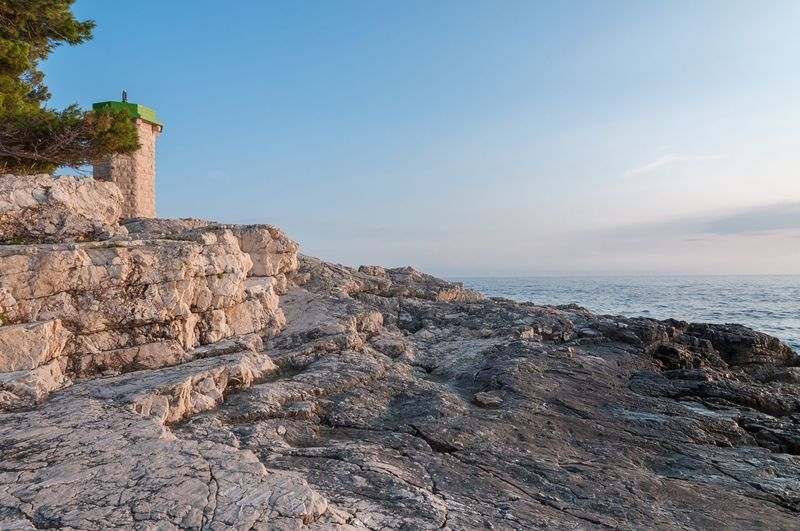 Lighthouse Sea Rock - Object Rock Formation Beauty In Nature Scenics Nature Horizon Over Water Architecture Clear Sky Outdoors Sky Day No People Water Cultures