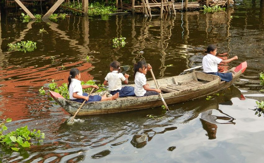On The Way Girls Rowing Boat Uniforms School Uniforms Around The World River View Water Reflections Floating On Water Culture And Tradition Tonlesap Cambodia