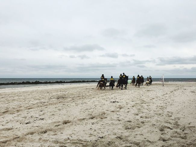 Land Beach Sea Sky Group Of People Sand Cloud - Sky Real People Water Nature Leisure Activity Horizon Over Water Beauty In Nature Lifestyles Riding Day Crowd Scenics - Nature Outdoors