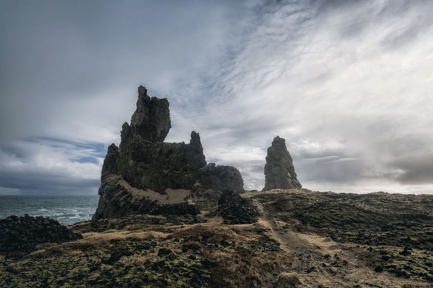 Landscape in Iceland Beauty In Nature Cliff Cloud Cloud - Sky Cloudy Day Geology Idyllic Landscape Nature No People Non-urban Scene Outdoors Overcast Physical Geography Remote Rock Rock - Object Rock Formation Scenics Sky Tourism Tranquil Scene Tranquility Travel Destinations
