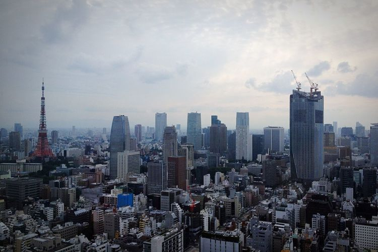 Tokyo Cityscape Against Cloudy Sky