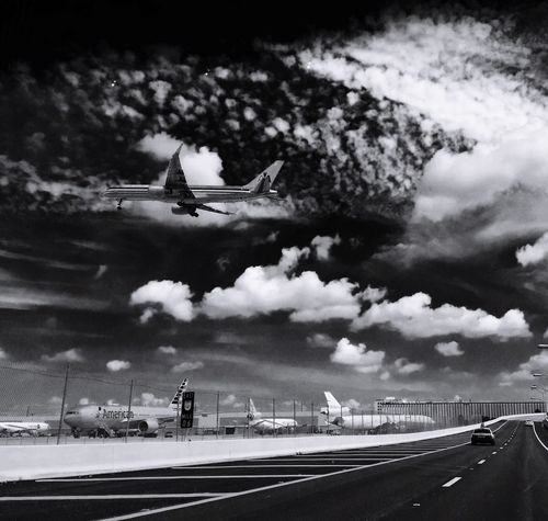 Transportation Mode Of Transport Journey Flying Travel Airplane Air Vehicle Road Sky Cloud - Sky Day Mid-air Land Vehicle Outdoors Runway Airport Built Structure Architecture No People Airplane Wing Blackandwhite Blackandwhite Photography Perspective California Dreamin