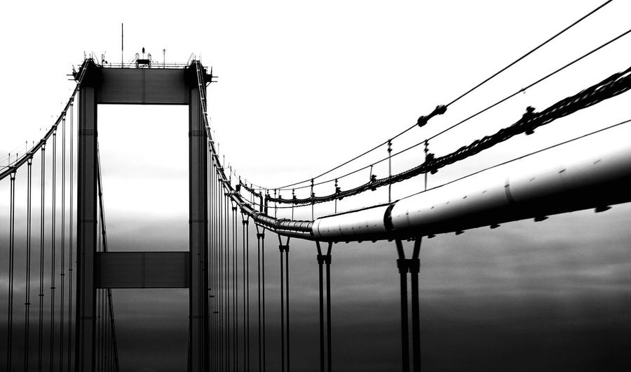 EyeEm Selects Suspension Bridge Connection Sky Outdoors Black And White Infrastructure Bridge Travel Leading Lines