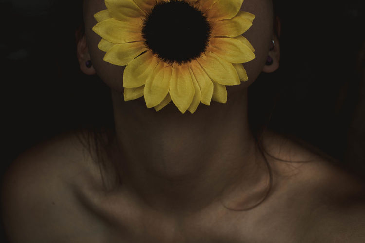 Beautiful Woman Black Background Body Part Close-up Flower Flower Head Flowering Plant Fragility Freshness Hairstyle Headshot Human Body Part Human Face Indoors  Inflorescence One Person Petal Plant Studio Shot Vulnerability  Yellow