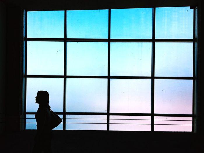 Silhouette woman walking in parking lot