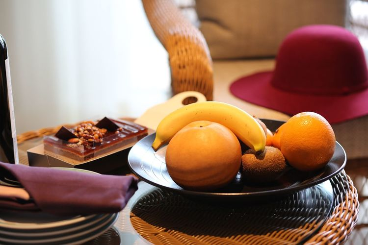 Close-up of orange fruits in basket on table