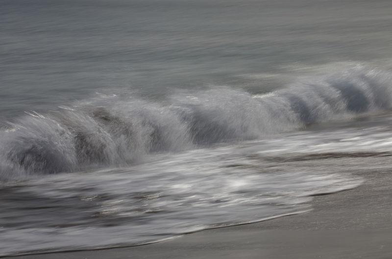 Sea waves splashing on shore