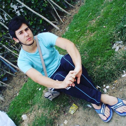 Full Length Casual Clothing Leisure Activity Person Grass Lifestyles Smiling Young Adult Relaxation Day Mature Adult Outdoors Green Color Alexandria