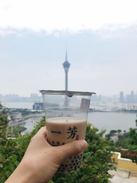 Macao view in Macao Human Hand Human Body Part Hand Drink Sky Architecture Built Structure Holding Building Exterior Food And Drink City Personal Perspective Day Lifestyles Focus On Foreground Disposable Refreshment EyeEmNewHere A New Beginning