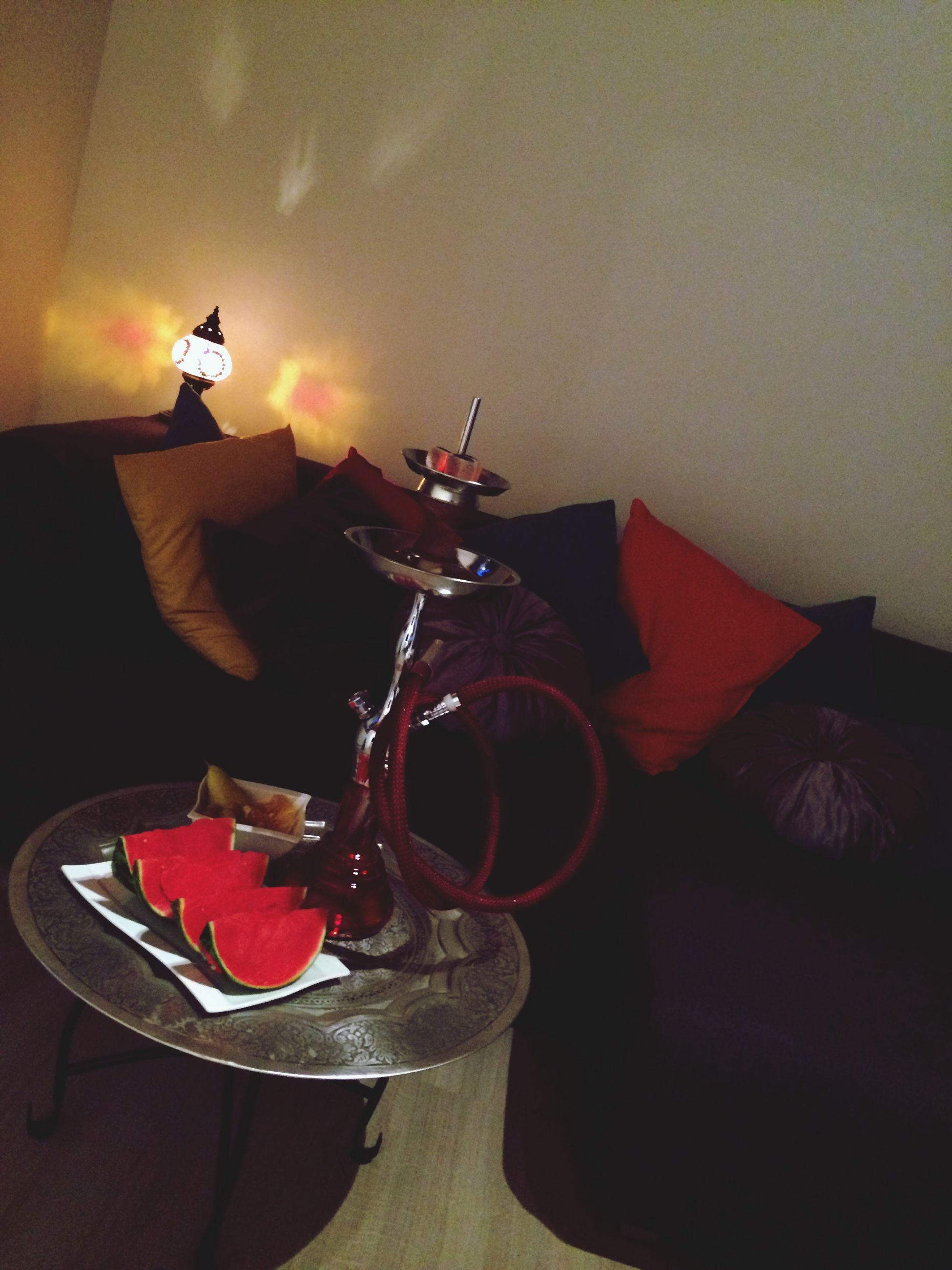 indoors, home interior, table, red, transportation, no people, still life, toy, mode of transport, decoration, lighting equipment, sunlight, close-up, low angle view, wall - building feature, shadow, hanging, day, built structure, glass - material
