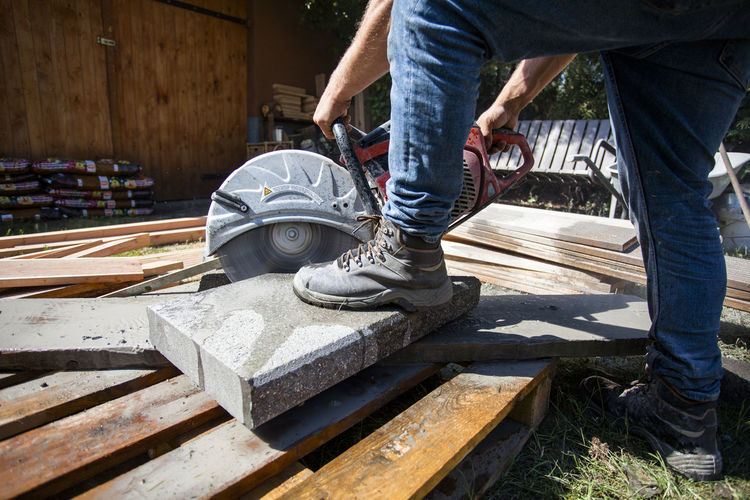 Construction Construction Site Construction Machinery Cutting DIY Do It Yourself Home Improvement Shape Working Brick Buidling Building Site Concrete Construction Work Construction Worker Craftsmanship  Garden Outdoors Power Saw Project Real People Saw Stone Tools Wood - Material