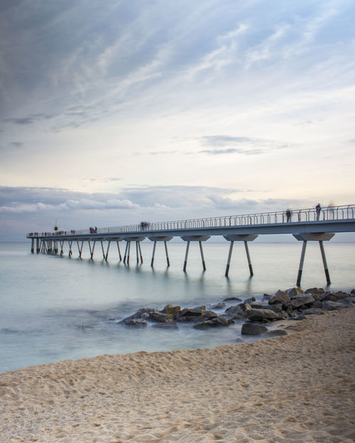 Pont Del Petroli, Badalona, Spain Sea And Sky Sea Beach Sea Water Pier Bridge - Man Made Structure Day Outdoors Beauty In Nature Horizon Over Water Sand Summer Blue Tranquility Building Exterior Vacations Scenics Built Structure Sky No People Nature