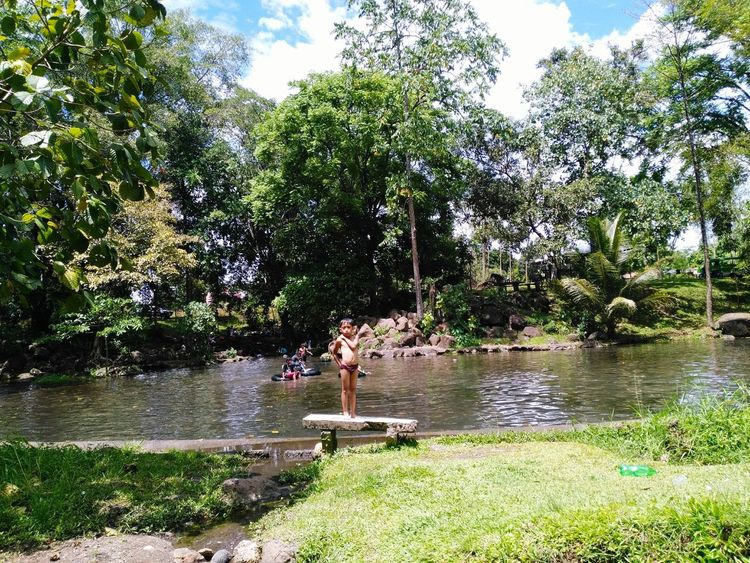 Water Tree Nature Growth Outdoors No People Day Beauty In Nature Tranquility Lake Green Color Branch Grass Sky Itsmorefuninthephilippines Personal Perspective Travelph Scenics Tranquility Human Body Part Water Slide