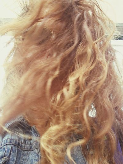 Human Hair Individuality One Person Close-up Women Day Blonde Curly Hair No Face Wind