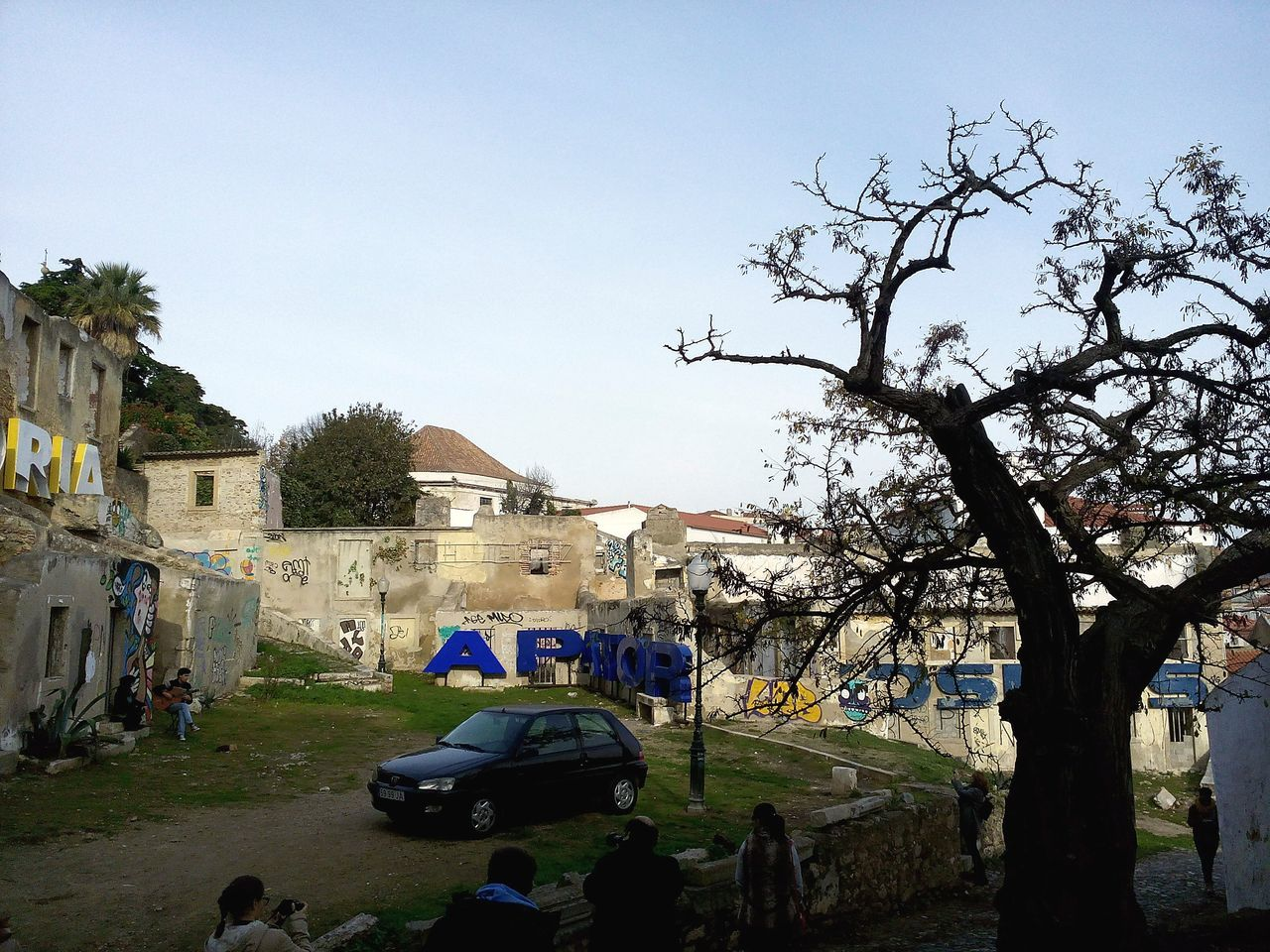 architecture, built structure, tree, building exterior, house, day, outdoors, real people, men, nature, sky, women, clear sky, people