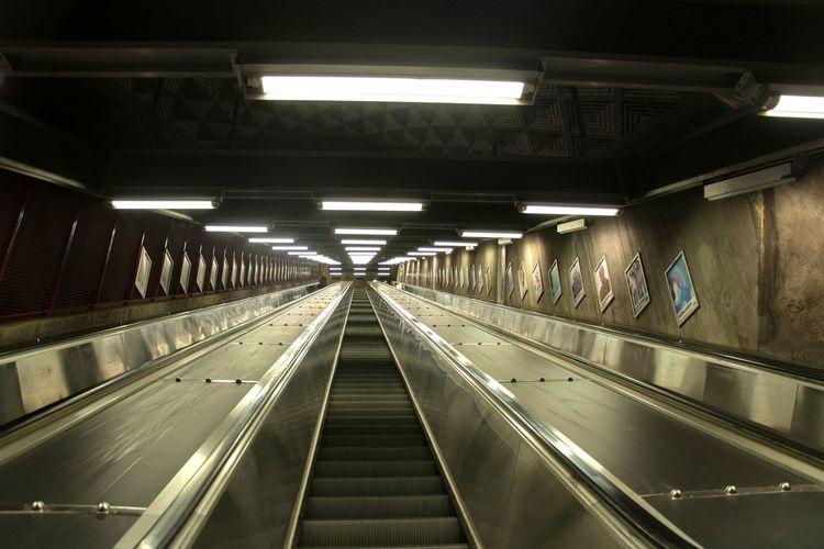 Low angle view of illuminated escalator