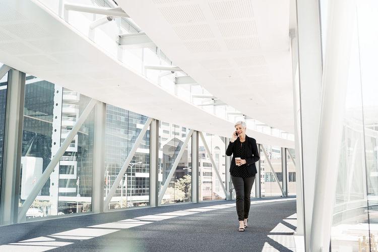 Full length of woman standing on bridge