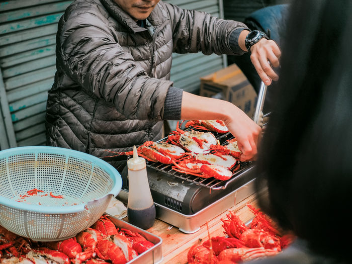 Food And Drink Food Freshness Real People Midsection Men Lifestyles People Selective Focus Raw Food Meat Holding Winter Standing Warm Clothing Casual Clothing Preparing Food Lobster Japanese Food Japanese Culture Adult Shrimp Shrimp - Seafood Boiled Grilled