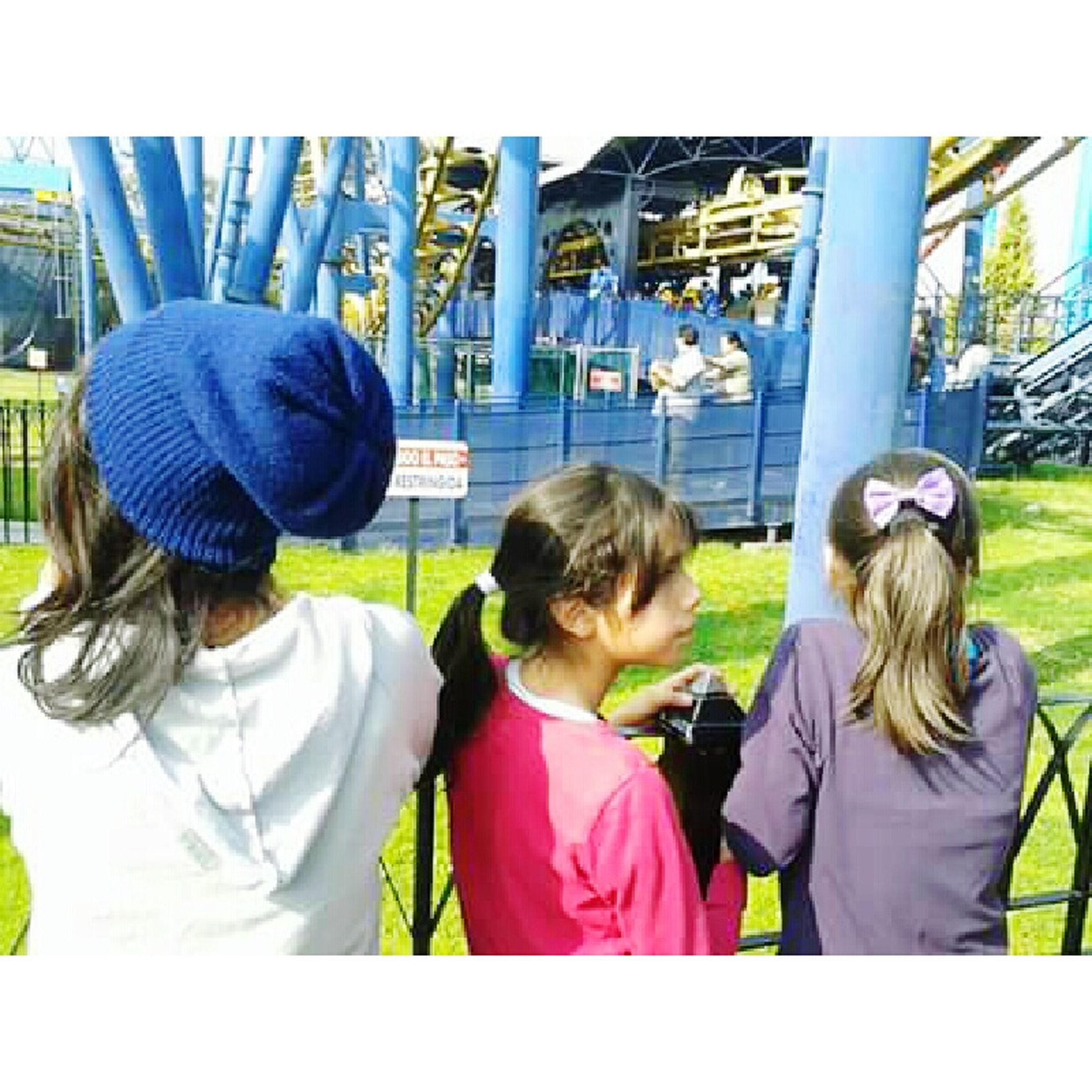 leisure activity, lifestyles, childhood, togetherness, casual clothing, boys, elementary age, bonding, person, girls, men, love, fun, sitting, waist up, enjoyment, park - man made space, playground