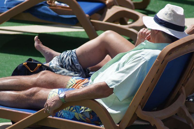 Man sitting in the sunlight with hat on. Short Sleeved Suntanned Nature_collection EyeEm Best Shots Side View Focus On Foreground Selective Focus Close-up Beauty In Nature Nature Incidental People Deck Mode Of Transport Nautical Vessel Hat Sunlight Lounger Legs Up Sitting Relaxation Leisure Activity Real People Lifestyles Day Sitting Casual Clothing One Person Adult Men Shorts