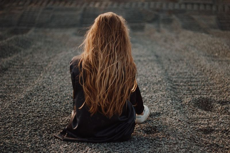 28 апреля. Трудности Sea People EyeEm Selects Rear View One Person Long Hair Hairstyle Hair Sitting Leisure Activity Land Real People Curly Hair Sunlight Nature Brown Hair Day Adult Human Hair Outdoors Women Lifestyles Solitude