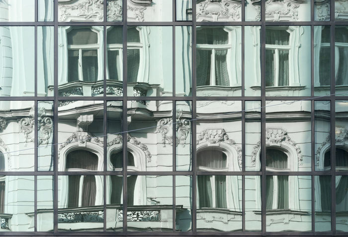 Old building reflected in modern glass window Arch Architecture Balcony Building Exterior Built Structure Carved Czech Republic Day Decoration Frame Glass Modern Moulding No People Outdoors Plaster Prague Rectangle Reflection Street Tradition Window