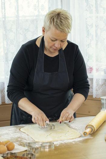 Full length of woman preparing food at home