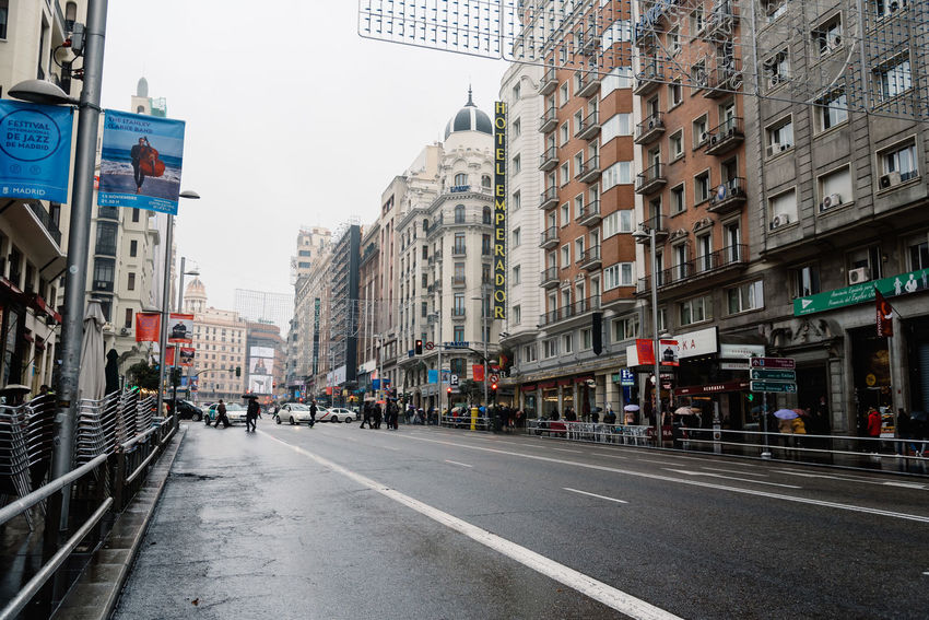 Perspective of Gran Via Avenue in Madrid Adult Adults Only Architecture Building Exterior Built Structure City City Life City Life City Street Cityscape Commercial Street Day Europe Gran Via Gran Via, Madrid Madrid Outdoors People Sky Street Travel Destinations Urban Urban Skyline