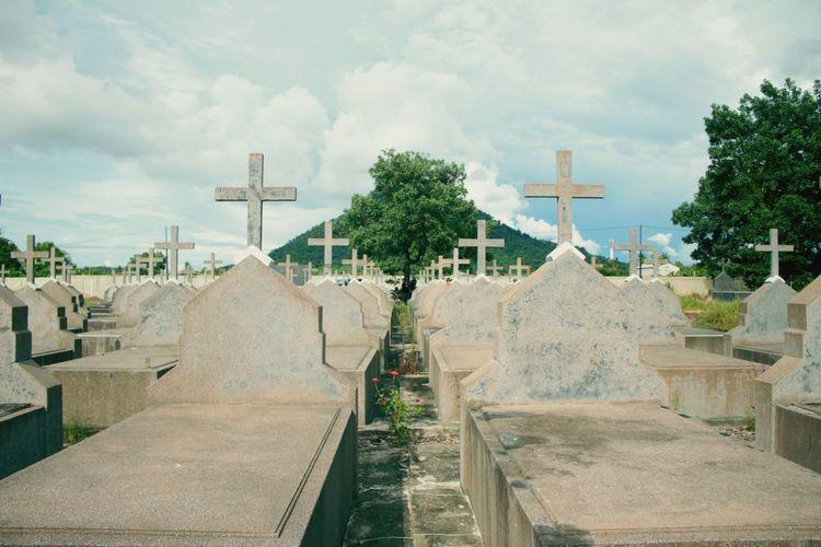 Cemetery Against Cloudy Sky