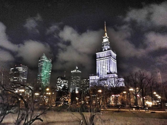 Warsaw Palace Of Culture And Science In Warsaw Palace Of Culture Warsaw Poland Travel Low Angle View Outdoors City Star - Space Cityscape Built Structure Illuminated Night Sky Architecture Skyscraper