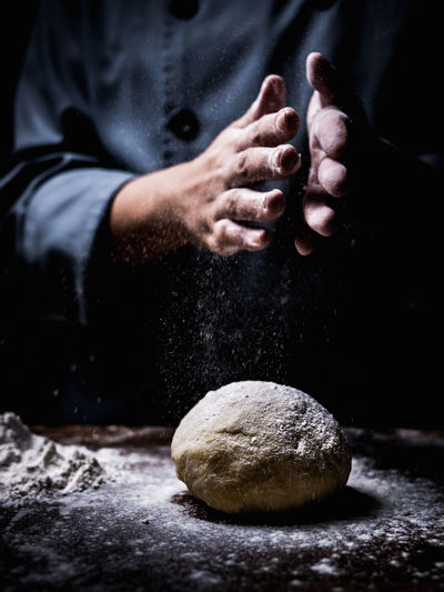 Bread Close-up Dough Food Food And Drink Hand Holding Human Body Part Human Hand Indoors  Men Midsection One Person Preparation  Preparing Food Real People Rock Solid Stone - Object