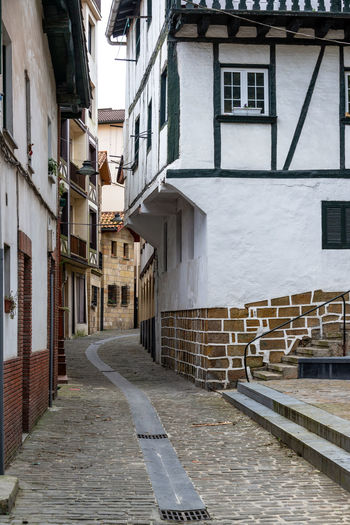 Narrow cobblestone street in the small village of Pasai Donibane, Spain Architecture Basque Country Country Donibane Euskadi Houses Pasai Donibane - Euskalherria Pasajes Passenger SPAIN San Sebastian Alley Building Cobblestone Colorful Guipuzcoa House Old Outdoors Pasaia Residential District Street Town Urban Village