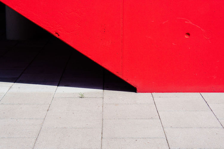 Footpath against red wall