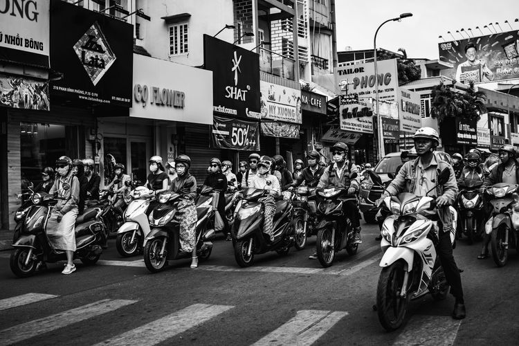Vietnam street photography Transportation City Building Exterior Street Architecture Mode Of Transportation Land Vehicle Real People Road Built Structure Motorcycle Group Of People City Life Scooter Motor Scooter Men Motor Vehicle Sign Women People Riding Biker Crash Helmet