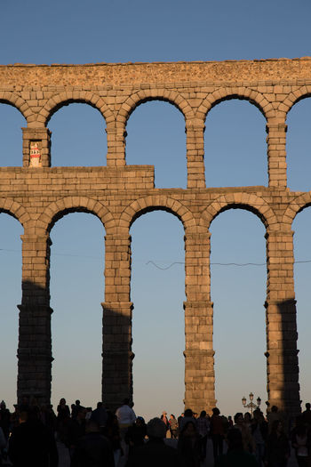 The Roman aquaduct in Segovia in Spain Ancient Ancient Civilization Arch Architectural Column Architecture Built Structure Column Culture Famous Place Historic History International Landmark Low Angle View Monument Old Ruin Sculpture Spain, Madrid, Tourism, Tourist, Buildings Statue The Past