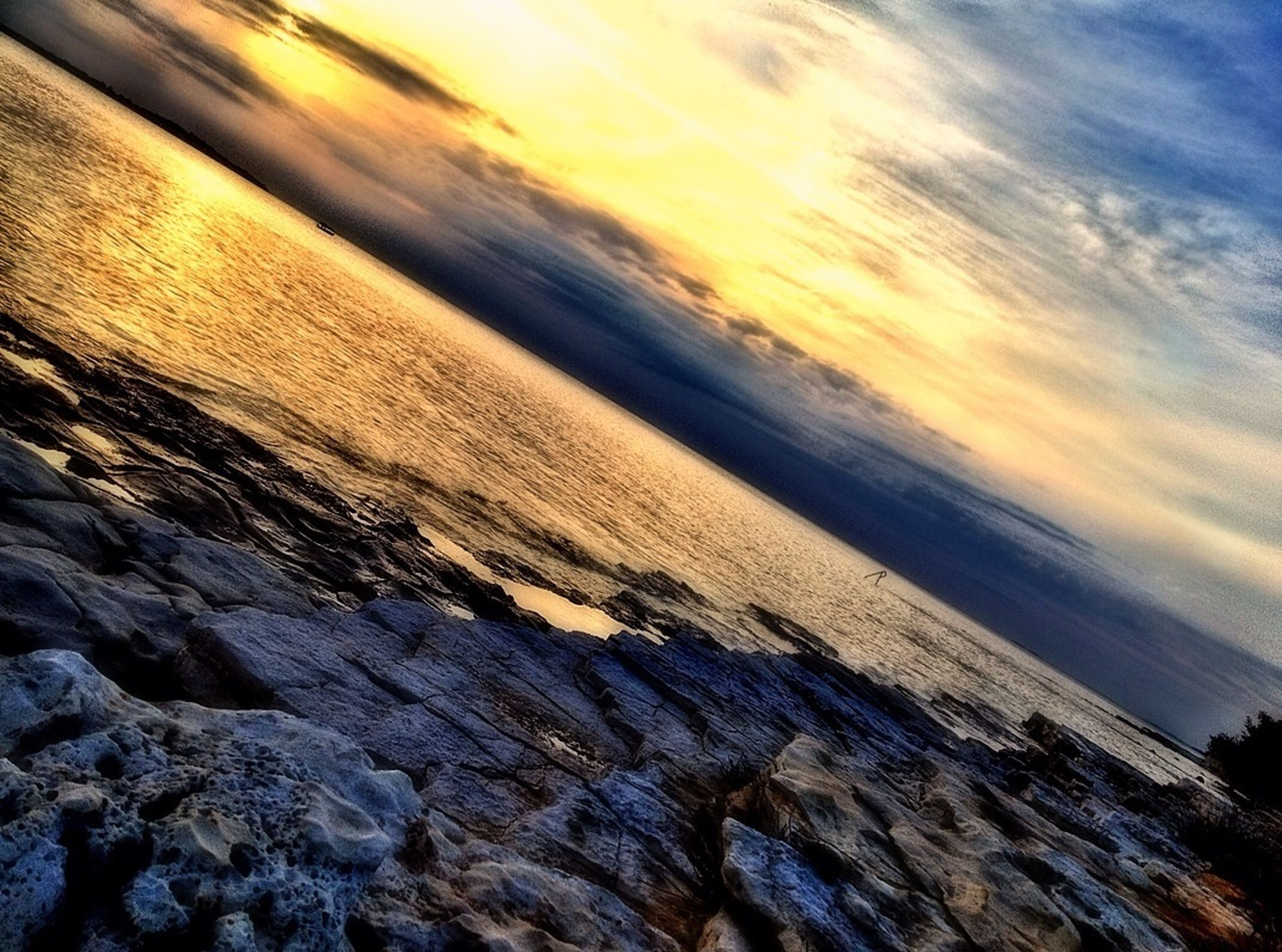 scenics, water, beauty in nature, sea, tranquil scene, sunset, tranquility, sky, beach, nature, cloud - sky, shore, idyllic, horizon over water, wave, rock - object, outdoors, surf, non-urban scene, sunlight