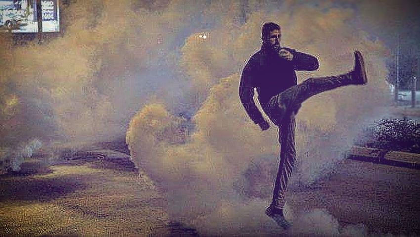 Kosovo Spraying Standing Outdoors