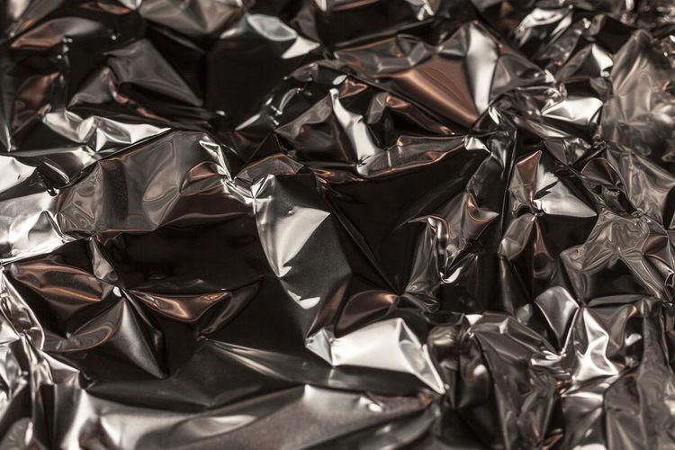 Full frame shot of crumpled aluminum foil