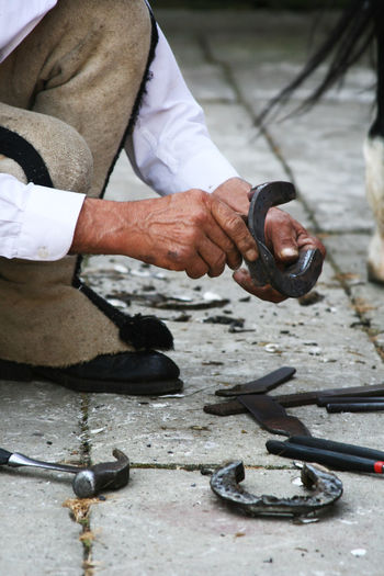 At Work Blacksmith  Forger Forgery Horseshoe Horseshoe Bend Mountaineer Tatry The Week On EyeEm Traditional Clothing Adult Blacksmithing Craftsmanship  Human Body Part Human Hand One Person Real People Shoeing Shoeing A Horse Skill  Smith Smithery Working This Is Masculinity This Is Aging
